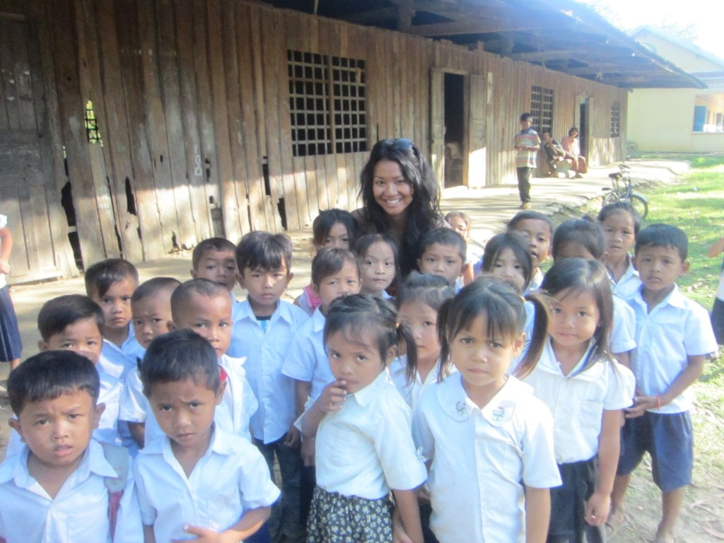Students of Souer Village standing in front of the main school buildings with Kim Im, GLEF supporter.