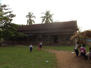 Phoum Bourn Svay Klaing Elementary School from the outside. Inside, open slits in the roof leak water during rain storms.
