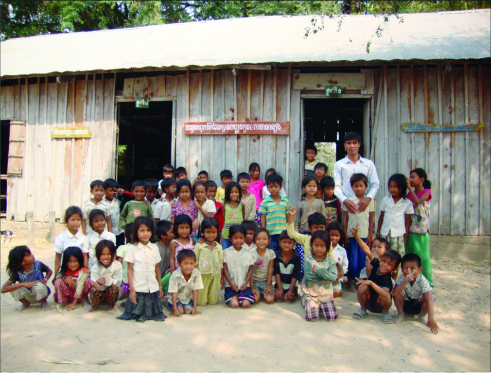 Koh Broteal Elementary School students and their teacher in front of their school, 2011
